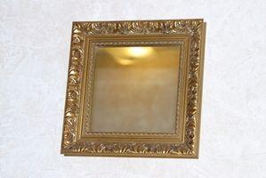Come appendere uno specchio su un camino in pietra