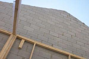 Come calcolare il numero di blocchi di cemento in una parete