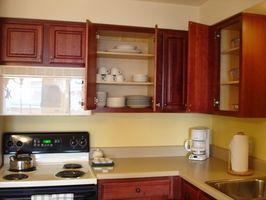 Come faccio a sostituire un forno a microonde Over-the-raggio che è di 14 centimetri in altezza?