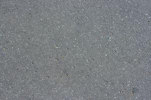 Come pulire olio motore su un pavimento di cemento